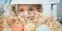 Cute little girl with  colorful easter eggs